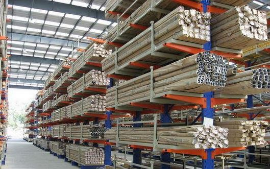 Warehouse full of blue and orange coloured Cantilever Racking storing long products.